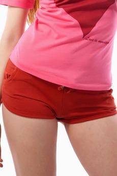Короткие оранжевые шорты Mondigo со скидкой